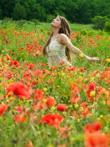 Girl in Field of flowers shutterstock_24343759